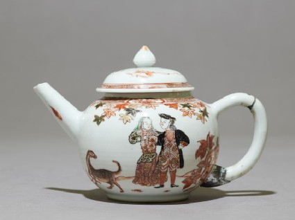 Teapot depicting a couple with a dogside