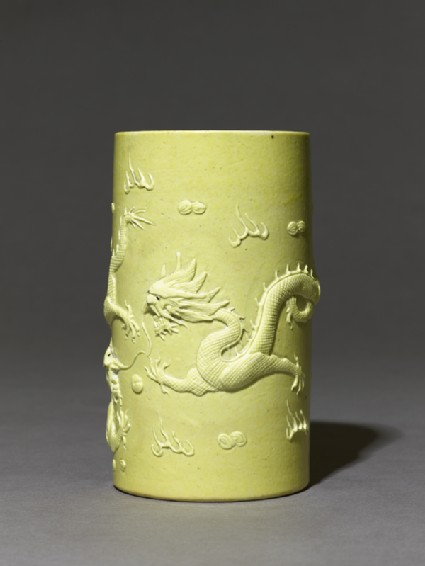 Brush pot with dragons in high reliefside