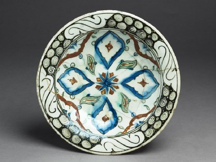 Dish with lobed medallions and leavestop