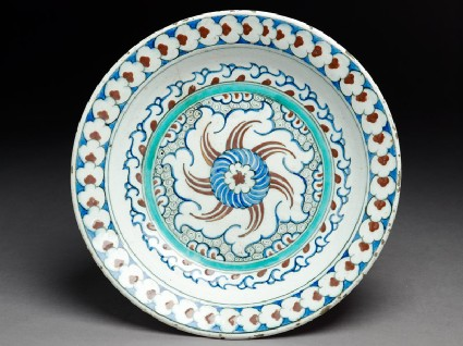 Dish with whirling rosette and prunus blossomtop