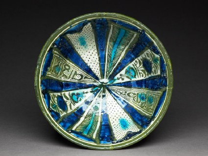 Bowl with radiating panelstop