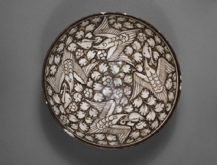 Bowl with flying phoenixes against a foliate backgroundtop