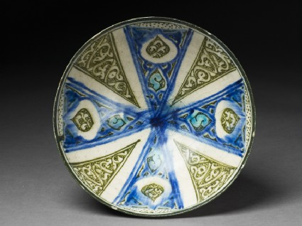 Bowl with radial design and drop-shaped cartouchestop