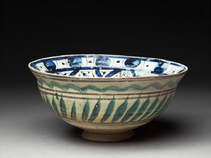 Bowl with central triangle and spiralling panelsoblique