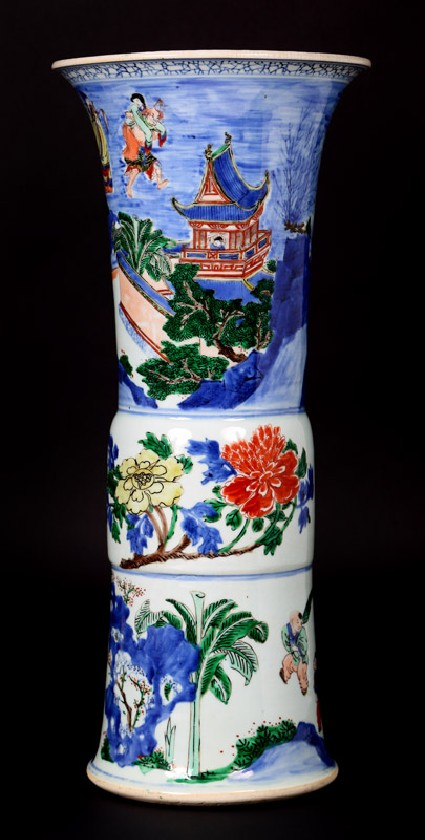 Beaker vase with flowers and figures in boatsfront