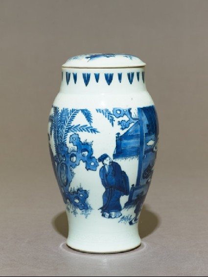 Blue-and-white jar and lid with couple in a gardenside