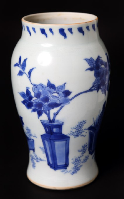 Blue-and-white vase with plants in containersfront
