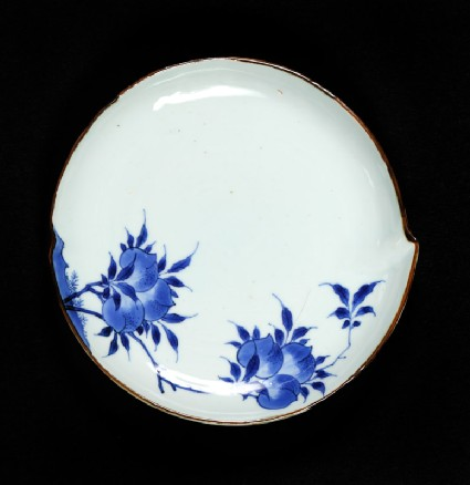 Blue-and-white dish with flowering peach branchesfront