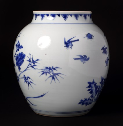 Blue-and-white jar with birds, rocks, and flowering branchesfront