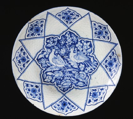 Dish with pheasants amid foliagetop