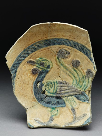 Fragment of a dish with peacocktop