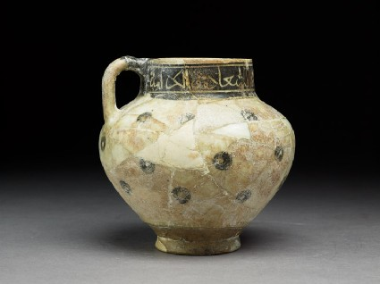Jug with circles and inscriptionside