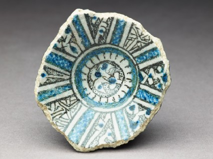 Base fragment of a bowl with central palmettetop