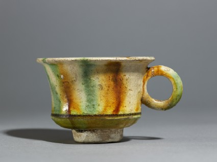 Cup with striped three-coloured glazeside
