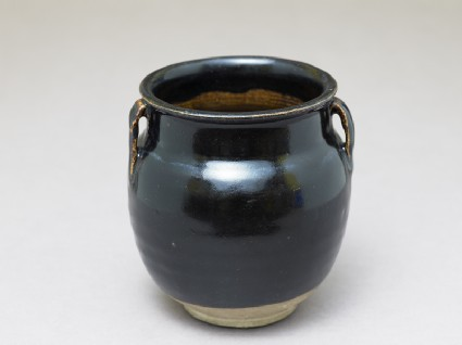 Black ware jar with black glazeoblique