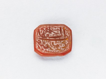 Octagonal bezel seal with nasta'liq inscription and spiral decorationfront