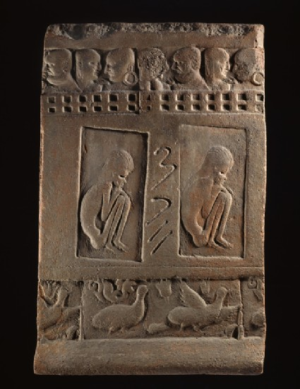 Terracotta tile with two ascetic figuresfront