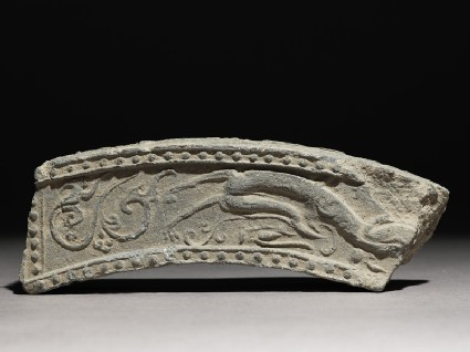 Fragment of a roof-tile with running dragonfront
