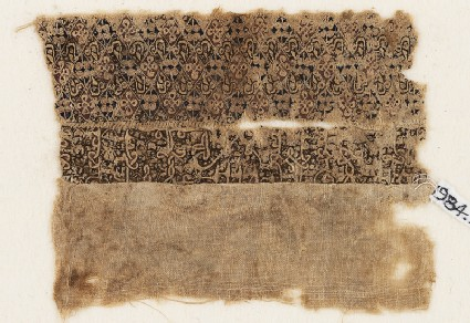 Textile fragment with quatrefoils and interlacing kufic scriptfront