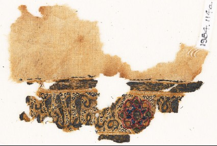 Textile fragment with naskhi inscription and circlesfront