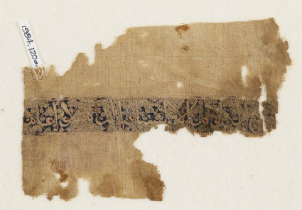 Textile fragment with naskhi inscription and scrolls, probably from a garmentfront