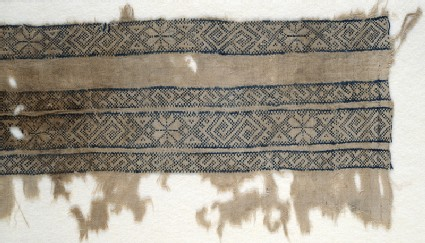 Textile fragment with bands of inverted hooks, flowers, and trianglesfront