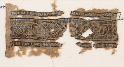 Textile fragment with bands of lozenges, stepped diamond-shapes, and trianglesfront