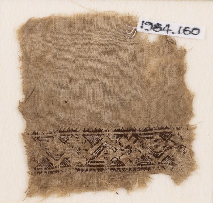 Textile fragment with stylized vine and flowersfront