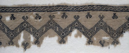 Textile fragment with chevrons and interlacing scrollsfront