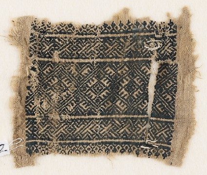Textile fragment with rectangle and linked diamond-shapesfront