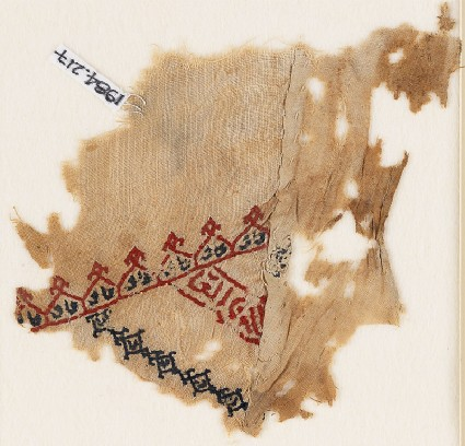 Textile fragment with linked crenellations and inscriptionfront