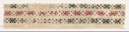Textile fragment with bands of V-shapes and diamond-shapesfront