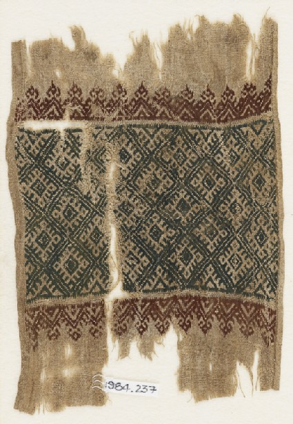 Textile fragment with linked diamond-shapes, triangles, and palmettesfront