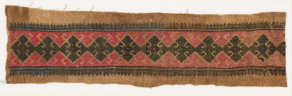 Textile fragment with diamond-shapes, triangles, and floral shapesfront