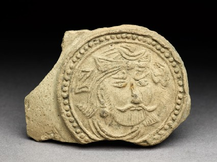 Medallion from a pot depicting a bearded figure, possibly a bodhisattvafront