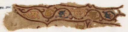 Textile fragment with tendrils and dragon headsfront