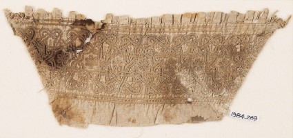 Textile fragment from a sleeve, with interlace, linked stars, and rosettesfront