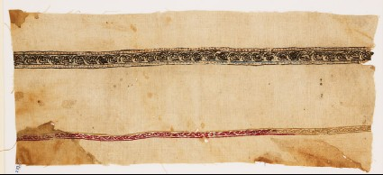Textile fragment with birds carrying leavesfront