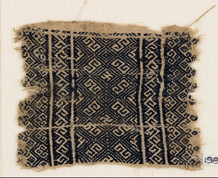 Textile fragment with diamond-shapes and S-shapesfront