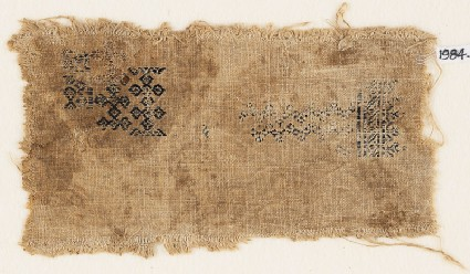 Textile fragment with linked quatrefoils and chevronsfront