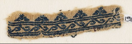 Textile fragment with scroll and floral trefoilsfront