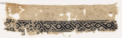 Textile fragment with scroll of linked S-shapes and rosettesfront