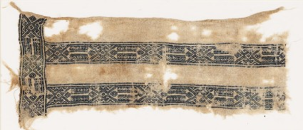 Textile fragment with linked hexagons, squares, and S-shapesfront