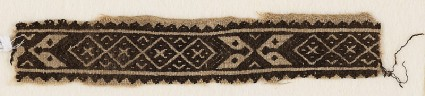 Textile fragment with band of linked-diamonds and cartouchesfront