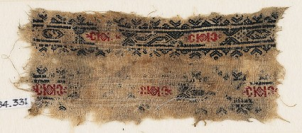 Textile fragment with bands of hexagonal cartouches, S-shapes, diamond-shapes, and crescentsfront