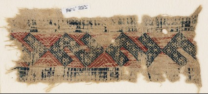 Textile fragment with linked S-shapes and crossesfront