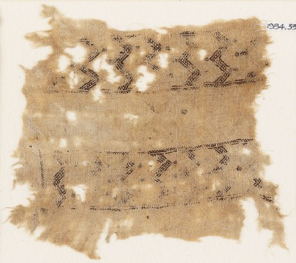 Textile fragment with bands of double chevrons and flowersfront