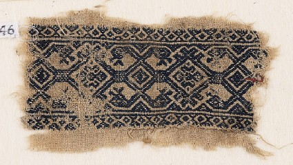 Textile fragment with interlace, and heads of serpents or birdsfront