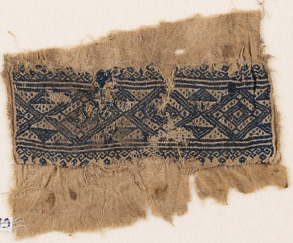 Textile fragment with linked diamond-shapes, triangles, and flowersfront