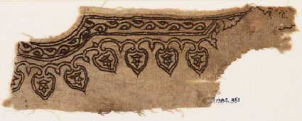 Textile fragment from the neck of a garment with vines and leavesfront